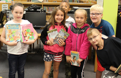 Picture of elementary students with books