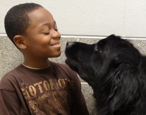 Student nose to nose with therapy dog