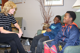 MS counselor visiting with students