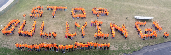 Middle school 6th grade students spell out Stop Bullying