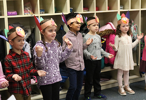 Students singing thanksgiving songs